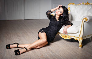 Wallpapers Brunette girl Wing chair Frock Legs Stilettos Beautiful young woman