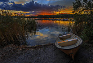 Photo Sweden Sunrises and sunsets Rivers Boats Berth Clouds Nature