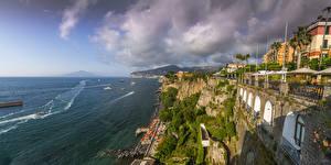 Desktop wallpapers Sorrento Italy Coast Houses Sea Rock Clouds Cities