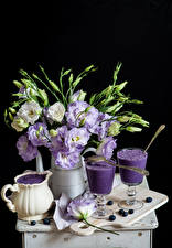 Picture Still-life Lisianthus Mixed drink Blueberries Black background Vase Jug container Stemware Cutting board Food