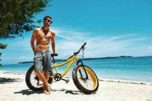 Pictures Man Coast Bicycles Eyeglasses Muscle Beautiful Beach athletic