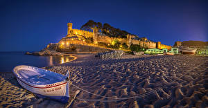 Pictures Spain Houses Fortress Evening Coast Boats Sand Street lights Tossa de Mar Catalonia Cities
