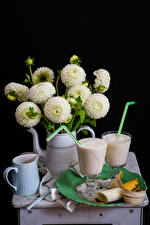 Pictures Still-life Dahlias Cocktail Bananas Black background Jugs White Highball glass Food Flowers