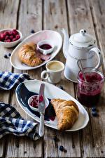 Photo Coffee Croissant Kettle Wood planks Breakfast Cup Plate Jar Food