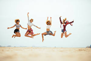 Pictures Beach Jump Legs Hands Glasses female