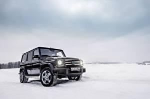 Fotos Mercedes-Benz G-Klasse Winter Schwarz Schnee W463