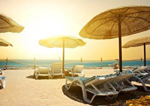Bilder Resort Strand Sonnenliege Regenschirm Natur