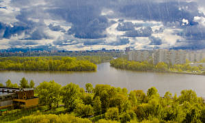 Desktop wallpapers Russia Moscow Houses Rivers Rain Clouds Cities