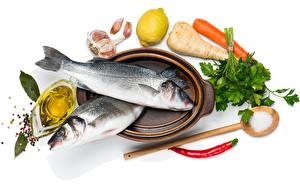 Pictures Seafoods Fish - Food Vegetables Garlic Lemons White background Food
