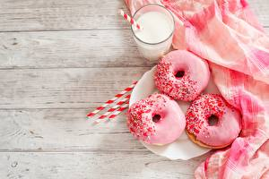 Фотография Пончики Сахарная глазурь Молоко Розовые Пища