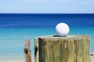 Bilder Golf Großansicht Ball Holzstamm