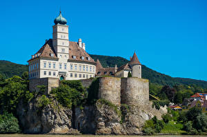 Bureaubladachtergronden Oostenrijk Burcht klif landform Schonbuhel Castle Steden