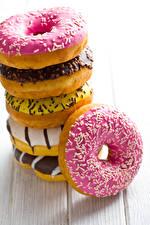 Картинка Выпечка Пончики Сахарная глазурь Доски Еда