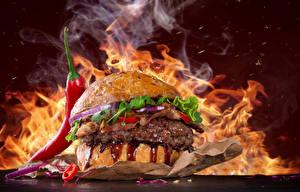 Bilder Fast food Burger Feuer Gemüse Chili Pfeffer das Essen