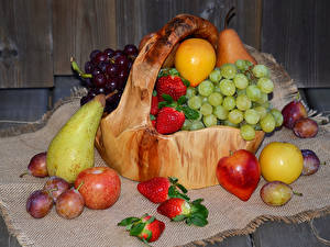 Pictures Fruit Grapes Strawberry Pears Plums Apples Wicker basket Food