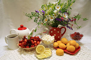 Pictures Still-life Bouquets Camomiles Cherry Apricot Lemons Tea Sweets Marmalade Cup Pitcher Food