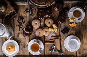 Fotos Tee Donut Zimt Schokolade Bretter Frühstück Tasse Getreide das Essen