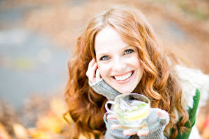 Pictures Drinks Smile Glance Cup Redhead girl Hair Girls