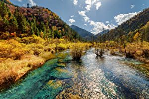 Images Jiuzhaigou park China Park Rivers Mountains Autumn Scenery Nature
