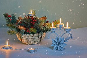 Image New year Candles Berry Wicker basket Branches Snow Snowflakes Conifer cone