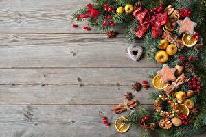 Bilder Neujahr Kekse Zitrone Zimt Bretter Ast Schleife Zapfen Lebensmittel