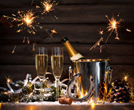 Images New year Holidays Sparkling wine Boards Stemware Conifer cone Sparkler Food
