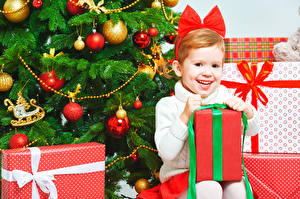 Pictures Christmas Holidays New Year tree Little girls Smile Gifts Sitting Balls child