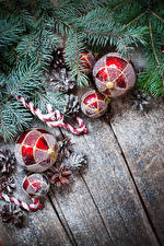 Picture New year Wood planks Branches Balls Conifer cone Snow