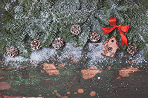 Images New year Boards Branches Conifer cone Snow Bowknot