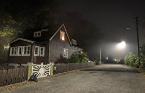 Pictures Sweden Stockholm Houses Roads Street Night Street lights Fence Cities
