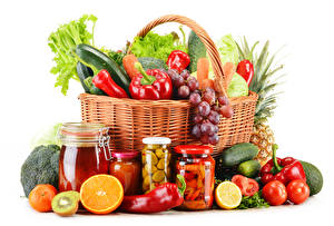 Photo Vegetables Fruit Citrus Bell pepper Tomatoes Cucumbers Grapes White background Wicker basket Jar Food