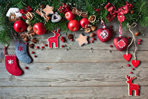 Photo New year Apples Cookies Deer Cinnamon Nuts Star anise Illicium Berry Wood planks Branches Socks Heart Food
