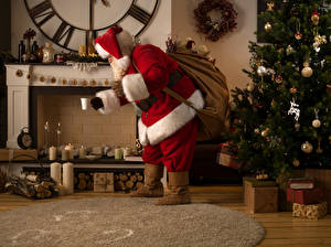 Pictures New year Candles Santa Claus Christmas tree Gifts Fireplace