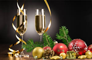 Images New year Champagne Gray background Stemware 2 Balls Conifer cone Branches Food