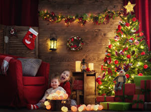 Picture Christmas Christmas tree Fairy lights Little girls 2 Present Wing chair Lantern child