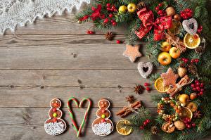 Hintergrundbilder Neujahr Kekse Äpfel Zimt Sternanis Bretter Ast Schneemänner Schleife Lebensmittel
