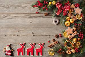 Hintergrundbilder Neujahr Kekse Hirsche Äpfel Zimt Bretter Ast Design Weihnachtsmann Zapfen Lebensmittel