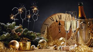 Picture New year Holidays Sparkling wine Clock 2018 Stemware Branches Balls Sparkler Food