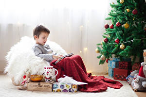 Image New year Holidays Christmas tree Balls Boys Gifts Cup Sitting Children