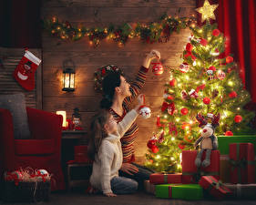 Picture New year Holidays Mother New Year tree Fairy lights Little girls Two Gifts Balls child Girls