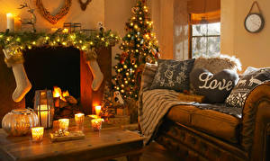 Image Christmas Holidays Interior Candles Couch Christmas tree Fairy lights Socks Pillows