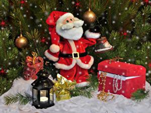 Fotos Neujahr Feiertage Weihnachtsmann Schatztruhe Laterne Kugeln Ast