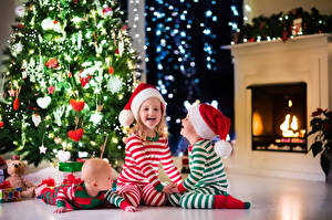 Picture New year Holidays Three 3 Christmas tree Winter hat Little girls Boys Infants Laughs child