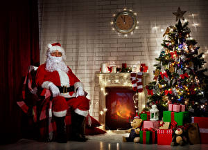 Picture Christmas Interior Clock Candles Walls Christmas tree Gifts Santa Claus Sitting Fireplace