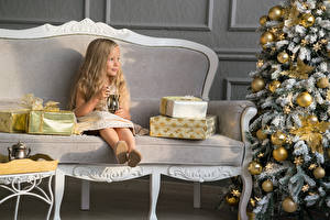 Picture New year Little girls Sofa Sitting Present New Year tree Balls child