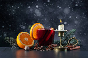 Picture New year Orange fruit Drinks Star anise Illicium Cinnamon Nuts Candles Highball glass Food