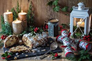 Fotos Neujahr Backware Kerzen Stillleben Ast Löffel Lebensmittel
