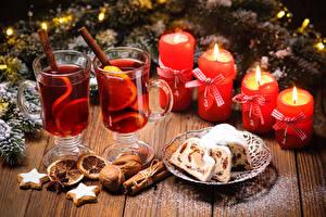 Bilder Neujahr Keks Schalenobst Zimt Kerzen Getränke Kekse Bretter Trinkglas