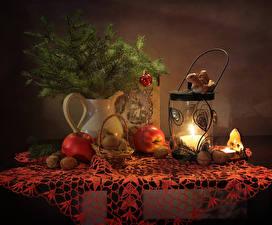 Bilder Neujahr Stillleben Kerzen Äpfel Nussfrüchte Ast Weidenkorb Laterne Lebensmittel