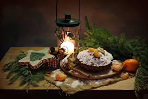 Hintergrundbilder Neujahr Stillleben Backware Keks Mandarine Zimt Kerzen Ast Lebensmittel